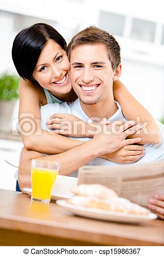 Woman hugs eating boyfriend