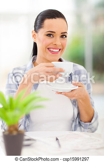 young adult woman drinking coffee - csp15991297