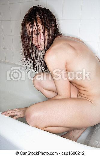 Nude woman in bathtub. - csp1600212