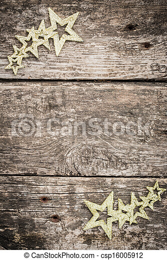 Gold Christmas tree decorations on grunge wood - csp16005912