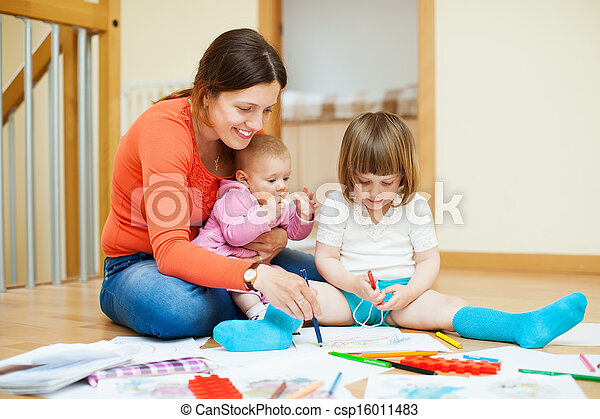 Happy mother with  children plays at home - csp16011483