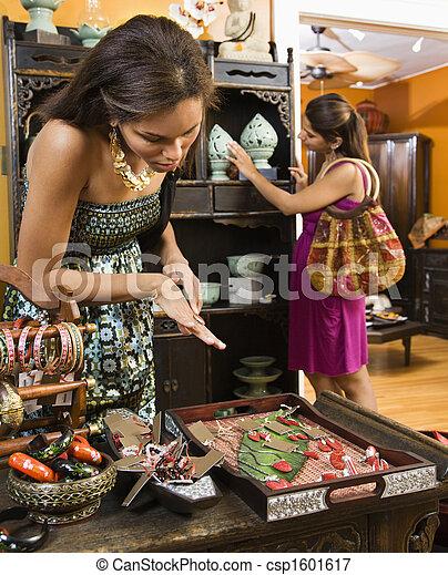 Women in boutique. - csp1601617