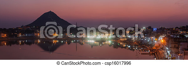 Panorama of Sacred Puskhar lake (Sagar) and ghats of  town Pushkar in twilight in the evening, Rajasthan, India - csp16017996