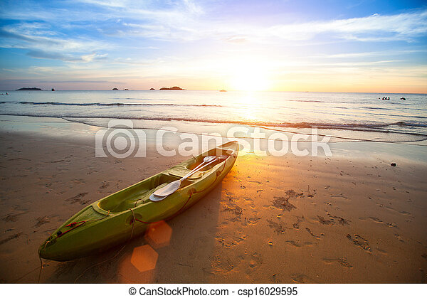 Kayak at the tropical beach at beautiful sunset. - csp16029595