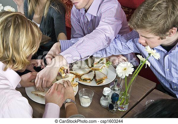 Grabbing sandwiches - csp1603244