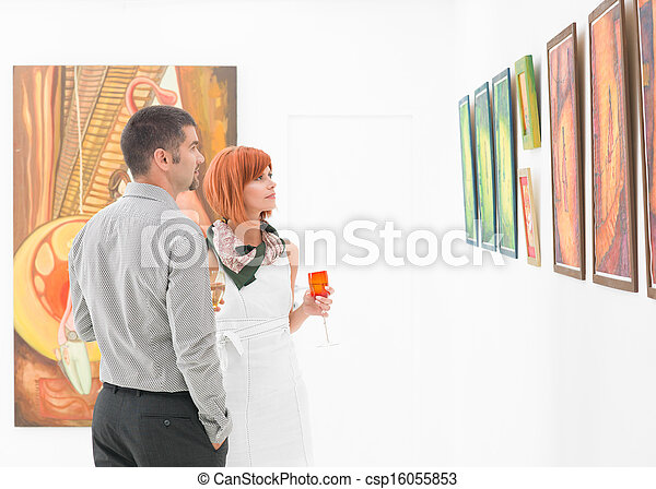people looking at art gallery paintings - csp16055853