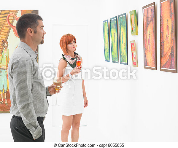 people reflecting on art in a museum - csp16055855