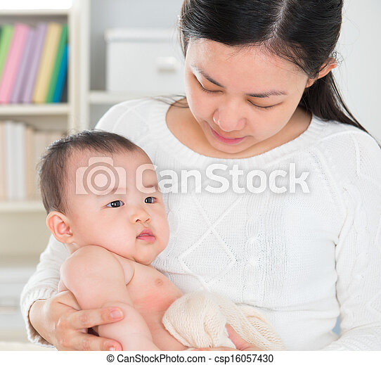 Asian mother pampering baby girl - csp16057430
