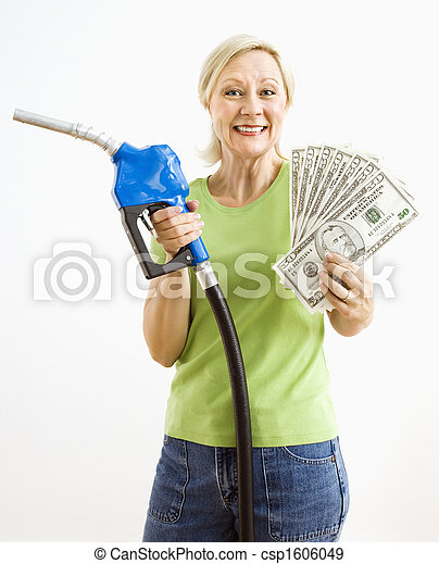 Happy woman with gas pump and money. - csp1606049