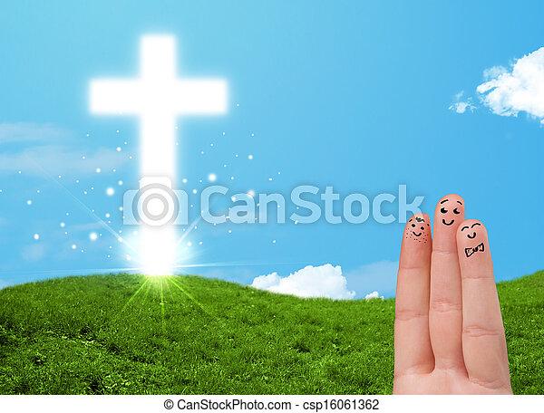 Happy finger smileys with christian religion cross - csp16061362