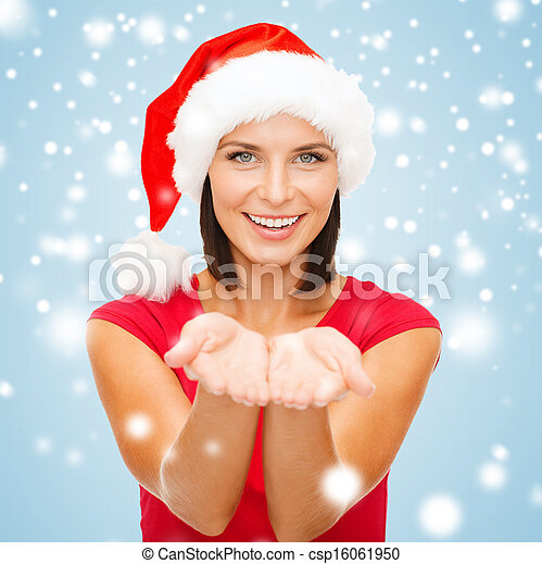 woman in santa helper hat with something on palms