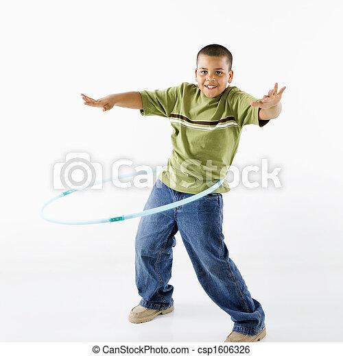Boy using hula hoop. - csp1606326