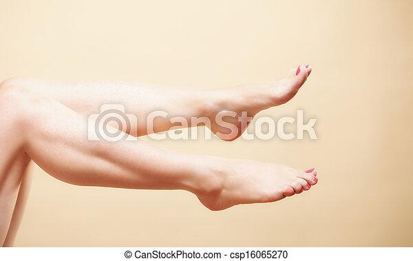 Beautiful long naked woman girl legs on orange - csp16065270