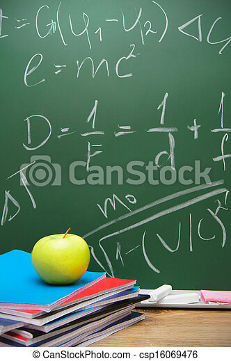 Apple and writing-books against a school board with mathematical formulas.