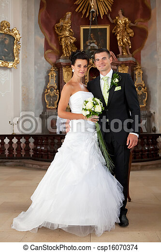 Young couple just married inside of church - csp16070374