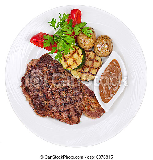 Grilled steaks, baked potatoes and vegetables on white plate isolated on white background. - csp16070815