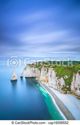Etretat Aval cliff and rocks landmark and ocean . Normandy, France. - csp16099552