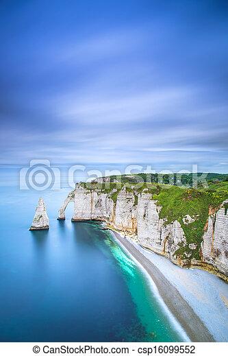 Etretat Aval cliff and rocks landmark and ocean . Normandy, France. - csp16099552