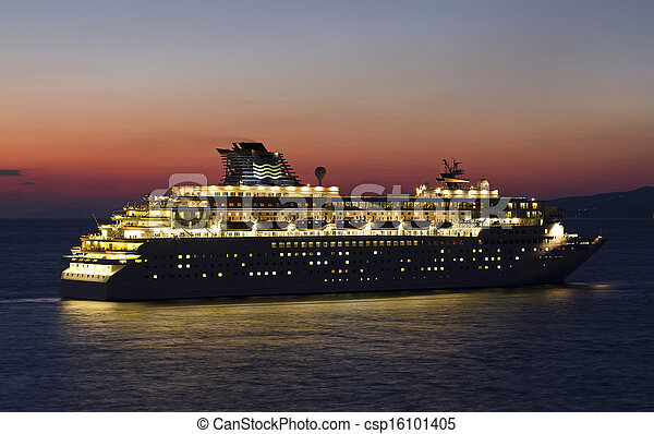 big cruise ship with lights open at sunset