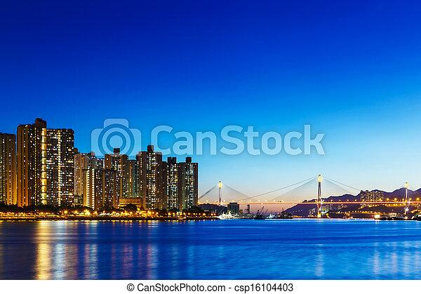Residential building in Hong Kong at night - csp16104403