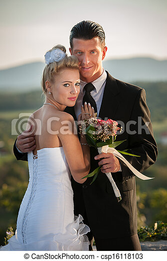 Bride and groom in a park outdoor - Married couple  - csp16118103