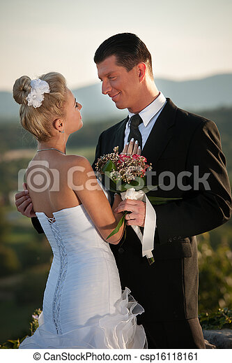 Bride and groom in a park outdoor - Married couple  - csp16118161