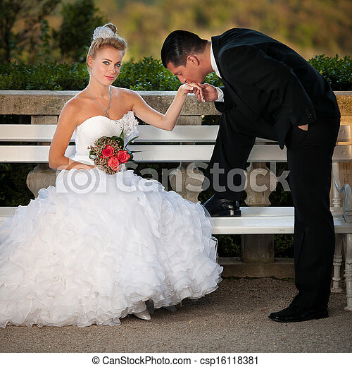 Bride and groom in a park outdoor - Married couple - csp16118381