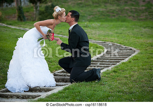 Bride and groom in a park outdoor - Married couple - csp16118618