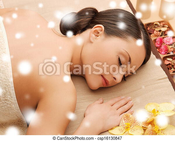 woman in spa salon lying on the massage desk - csp16130847