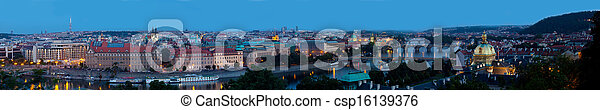 Panoramic view on bridges over the Vltava River in Prague at night - csp16139376