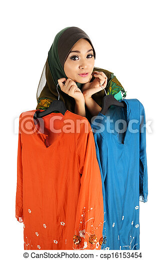 Pretty young Asian Muslim woman posses shopping with Baju Kurung action. Islamic fashionable attire concept - csp16153454