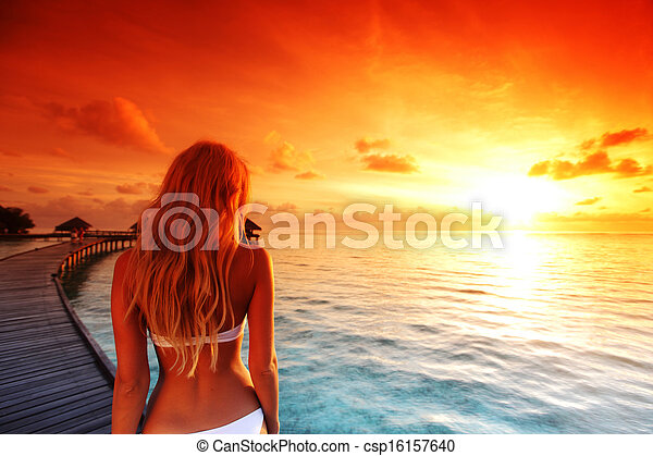 woman in a dress on maldivian sunset - csp16157640
