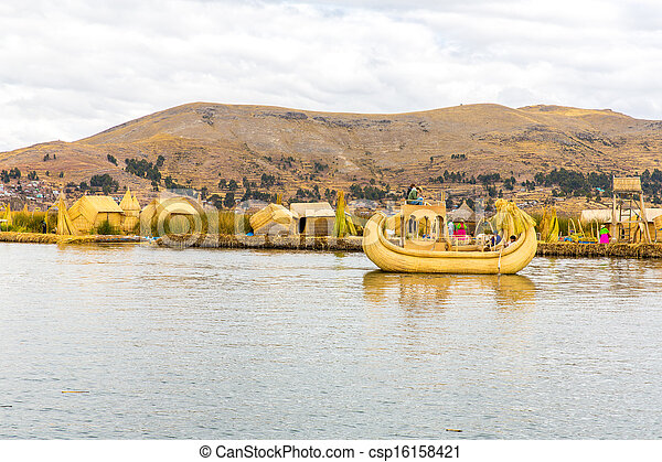 Traditional reed boat lake Titicaca,Peru,Puno,Uros,South America,Floating  Islands,natural layer about one to two meters thick that support islands - csp16158421