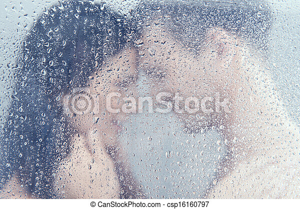 Loving couple in shower. Beautiful young loving couple hugging while standing in shower