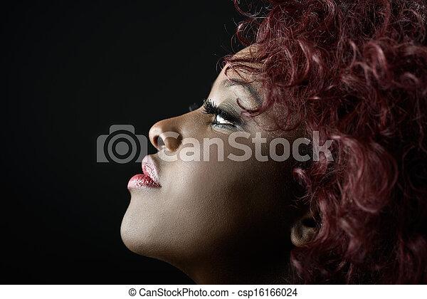 Beautiful black woman on black background. Studio shot - csp16166024