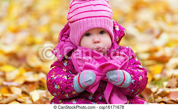 funny happy baby girl child outdoors in the park in autumn - csp16171678