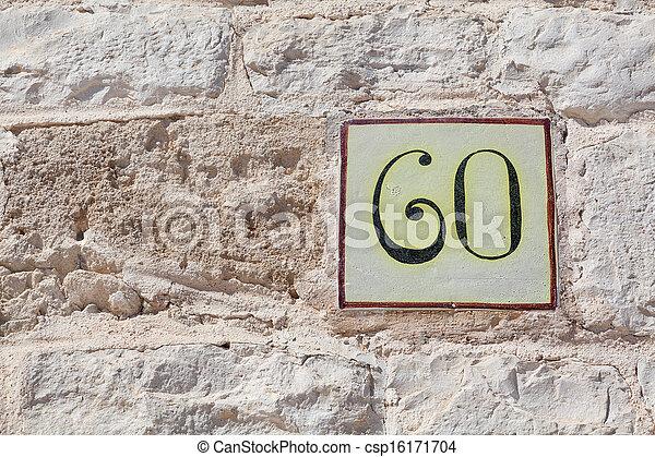 Stock de fotograf a de casa n mero sesenta cuadrado for Azulejo numero casa