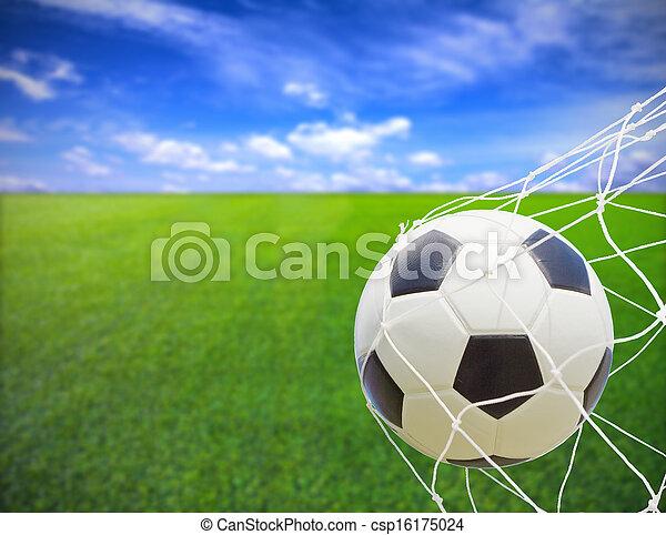 Soccer ball in gold net