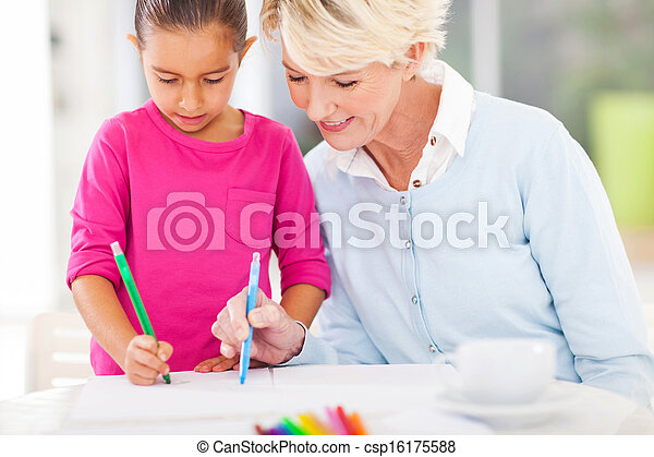 grandma teaching granddaughter drawing