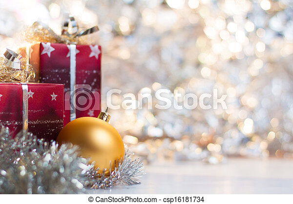 Christmas ball and gifts on abstract light background - csp16181734