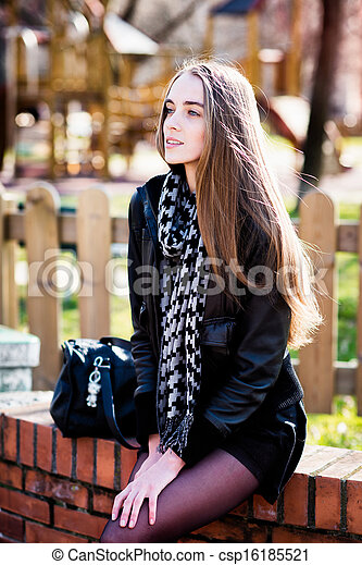 Fashion woman with a bag in the park - csp16185521