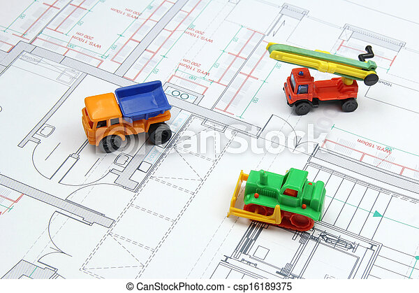 architectural plans and toy bulldozer, dump truck - csp16189375