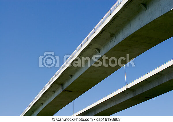 Pair of highway bridges on blue sky - csp16193983