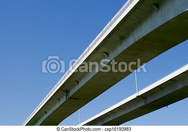 Pair of highway bridges on blue sky - csp16193983