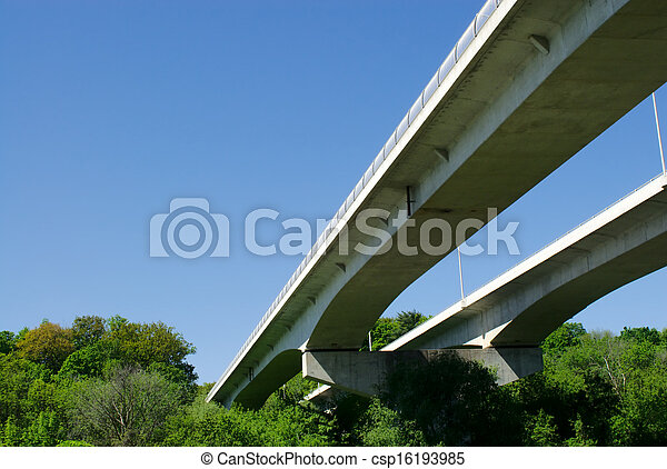 Pair of highway bridges on sky and forest - csp16193985
