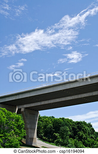 Pair of bridges crossing forest on sky - csp16194094