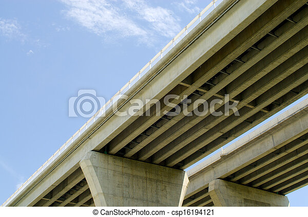 Underside of highway bridges on blue sky - csp16194121