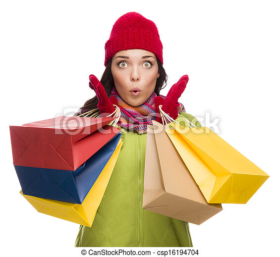 Mixed Race Woman Wearing Hat and Gloves Holding Shopping Bags - csp16194704