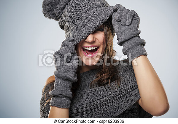 Young woman have fun with winter clothing - csp16203936