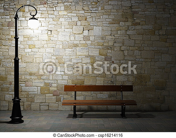 Night view of the illuminated brick wall with old fashioned street light and bench - csp16214116